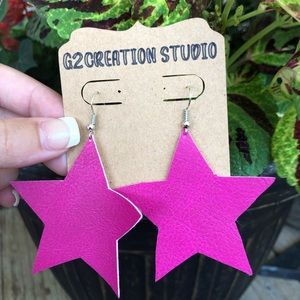 Faux star leather earrings.